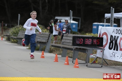 Here is my amazing son running to finish the 5K portion of our 8K race.  He inspires and motivates me with his athletic abilities!